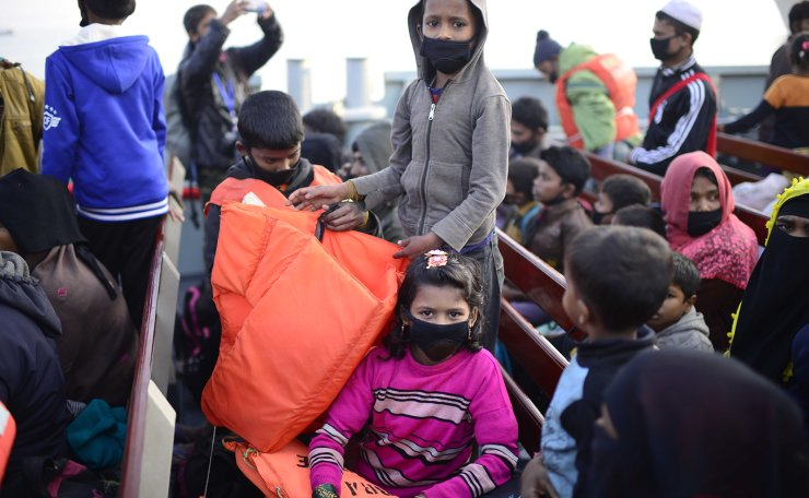 Rohingya refugees travel in a naval ship to be transported to an isolated island in the Bay of Bengal, in Chittagong, Bangladesh, Tuesday, Dec. 29, 2020.  AP