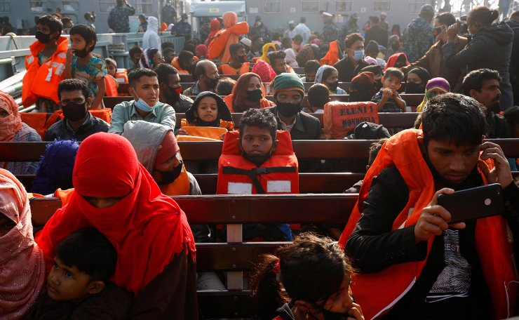 Rohingya refugees sit on a navy vessel carrying them to Bhasan Char island in Noakhali district, Bangladesh, December 29, 2020. Reuters