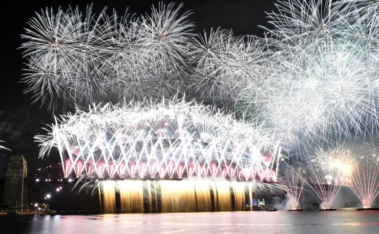The midnight fireworks light up Sydney Harbour and the Sydney Harbour Bridge during New Year's Eve celebrations in Sydney, Australia, 01 January 2021. Sydneysiders were asked to stay home and watch the fireworks on television this year to due the COVID-19 pandemic. EPA