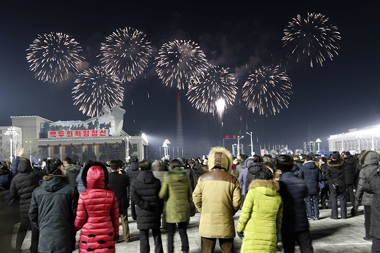 People watch the national flag raising ceremony and fireworks display to celebrate the New Year, at Kim Il Sung Square in Pyongyang, North Korea, early Friday, Jan., 1, 2021. AP