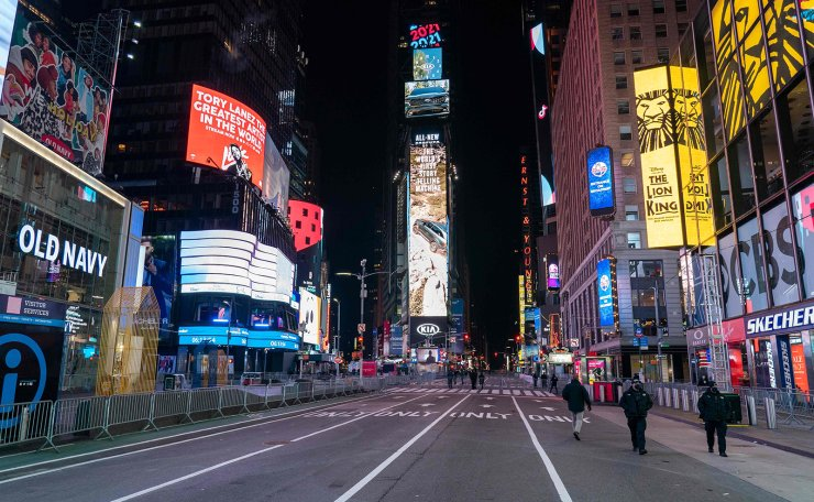 Police officers walk in a nearly empty Times Square due to Covid-19 restrictions on New Year's Eve in New York City, December 31, 2020. AFP