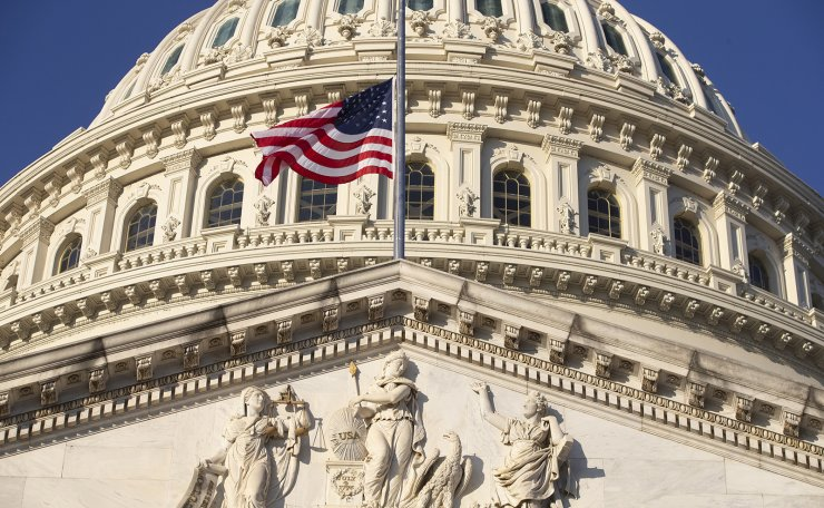 The US national flag is seen flying at half-staff at the US Capitol in Washington, DC, USA, 12 January 2021. EPA