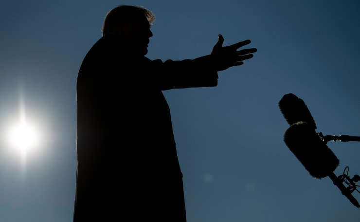 US President Donald Trump speaks to the media outside the White House on January 12, 2021 in Washington,DC before his departure to Alamo, Texas. AFP