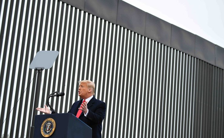 US President Donald Trump speaks after touring a section of the border wall in Alamo, Texas on January 12, 2021. AFP
