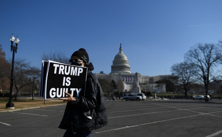 Laurie Arbeiter protests against U.S President Donald Trump near the U.S. Capitol building, as the House of Representatives debates impeaching U.S. President Donald Trump a week after his supporters stormed the Capitol building in Washington, U.S., January 13, 2021. Reuters