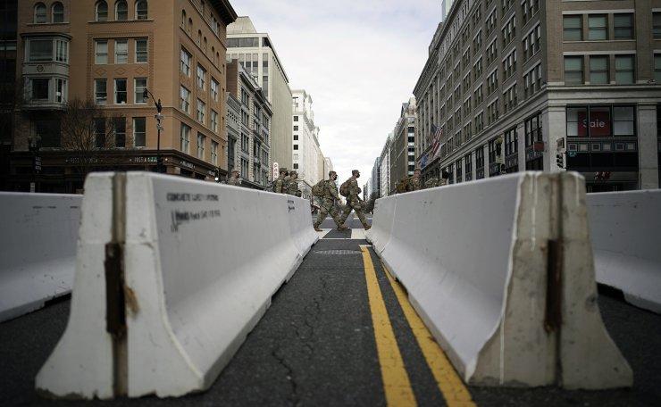 National Guard security is increased ahead of the inauguration of President-elect Joe Biden and Vice President-elect Kamala Harris, Sunday, Jan. 17, 2021, in Washington. AP