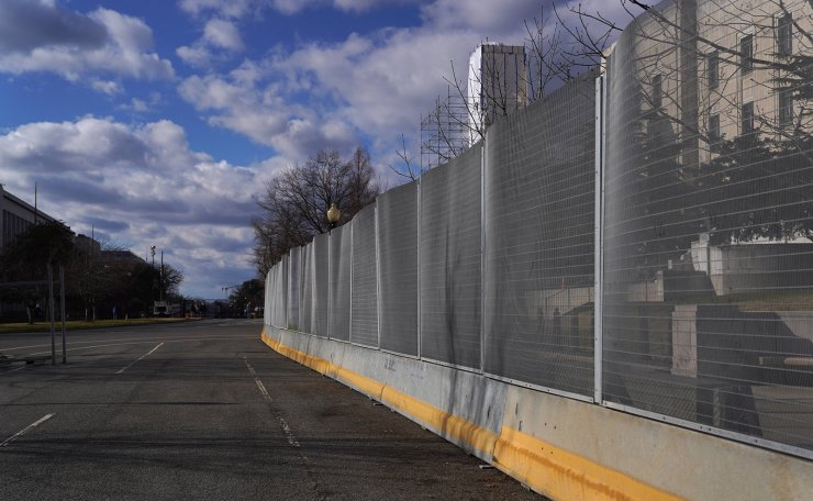 Security fencing runs down an empty street near the U.S. Capitol on January 17, 2021 in Washington, DC. AFP