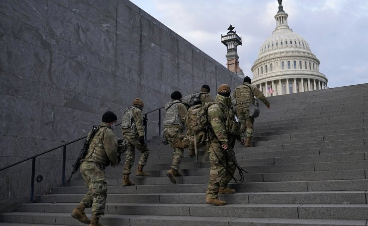 National Guard members take a staircase toward the U.S. Capitol building before a rehearsal for President-elect Joe Biden's Presidential Inauguration in Washington, Monday, Jan. 18, 2021. AP