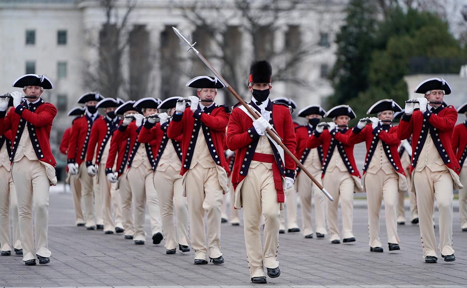 Military Band members dressed in 18th century costumes rehearse near the U.S. Capitol Hill, ahead of U.S. President-elect Joe Biden's inauguration, in Washington, U.S., January 18, 2021. Reuters