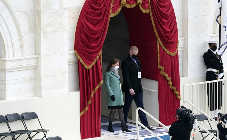 Stand-ins for President-elect Joe Biden and Jill Biden, walk on to the podium during a rehearsal for the 59th Presidential Inauguration at the U.S. Capitol in Washington, Monday, Jan. 18, 2021. AP