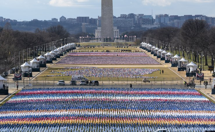 Flags are placed on the National Mall, looking towards the Washington Monument, and the Lincoln Memorial, ahead of the inauguration of President-elect Joe Biden and Vice President-elect Kamala Harris, Monday, Jan. 18, 2021, in Washington. AP