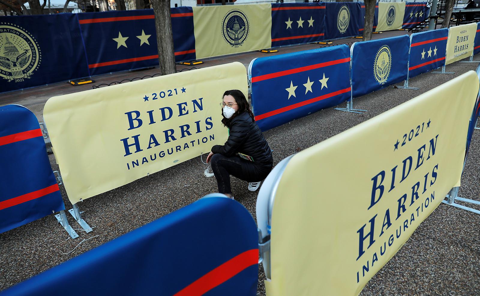 A volunteer sets up preparations for U.S. President-elect Joe Biden's inauguration, in Washington, D.C., U.S., January 18, 2021. Reuters