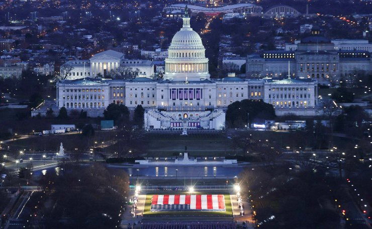 The U.S. Capitol Building is prepared for the inauguration ceremonies for President-elect Joe Biden as the 'Field of Flags' are placed on the ground on the National Mall, in Washington, U.S., January 18, 2021. Reuters