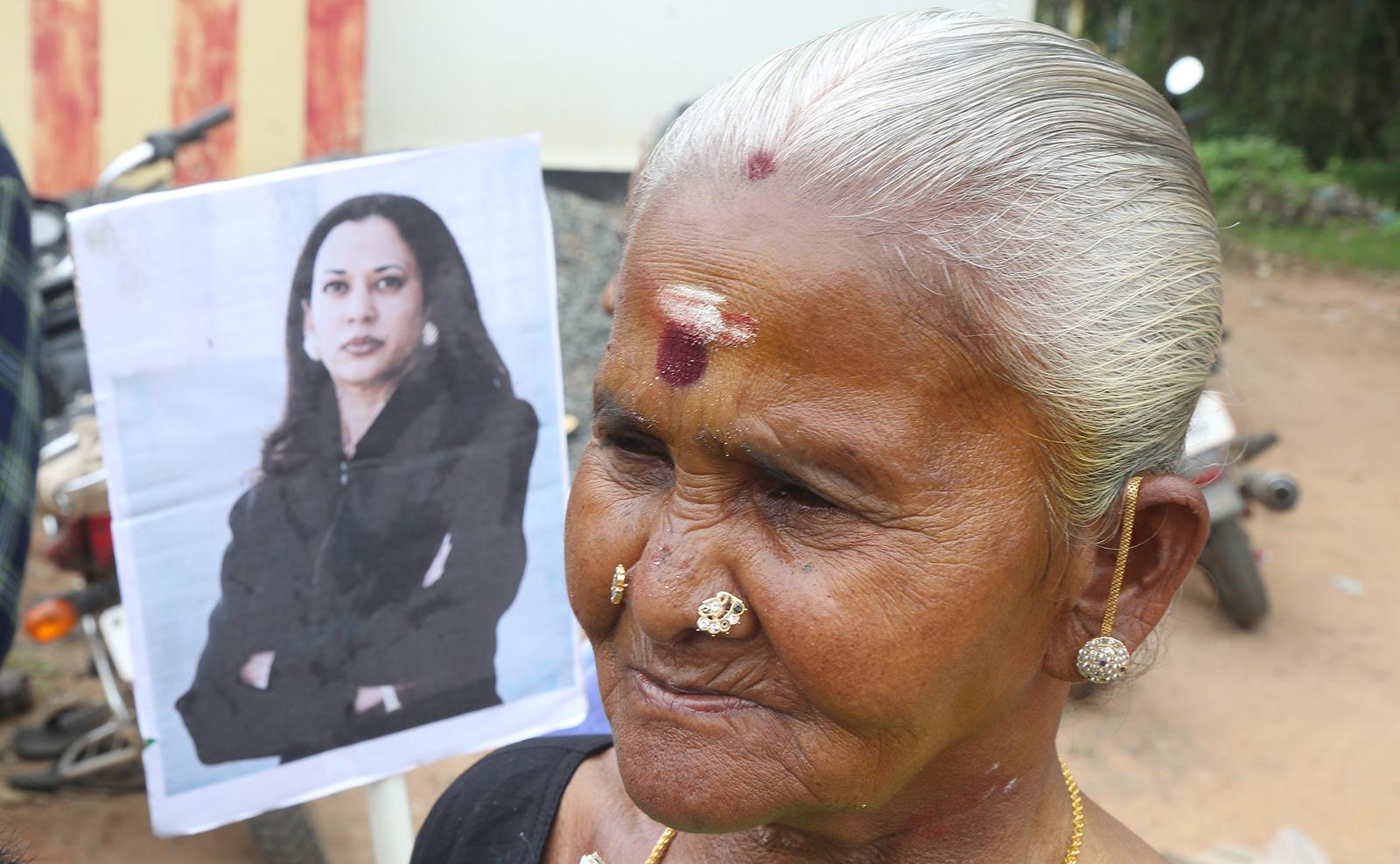 A villager stands next to photo of US Vice President-elect Kamala Harris at Thulasendrapuram village in Tamil Nadu, India, 20 January 2021. EPA