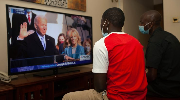Kenyans watch President-elect Joe Biden's inauguration on the television, in Nairobi, Wednesday, Jan. 20 2021. Biden has officially become the 46th president of the United States. AP