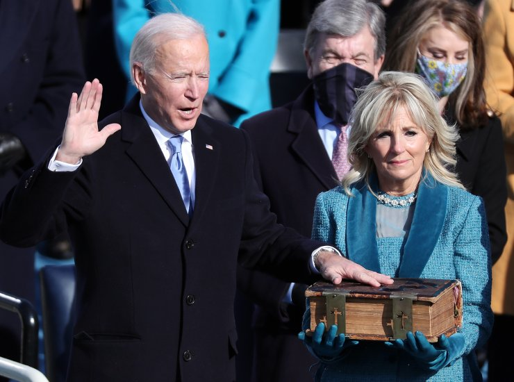 US President-elect Joe Biden (L) stands with Dr. Jill Biden (C) as he is given the oath of office by Chief Justice John Roberts of the Supreme Court during the inaugural ceremony for President-elect Joe Biden and Vice President-elect Kamala Harris on the West Front of the U.S. Capitol in Washington, DC, USA, 20 January 2021. EPA