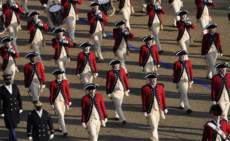 Members of the Old Guard Fife and Drum Corps march near the White House during the Presidential Escort, part of Inauguration Day ceremonies, Wednesday, Jan. 20, 2021, in Washington. AP