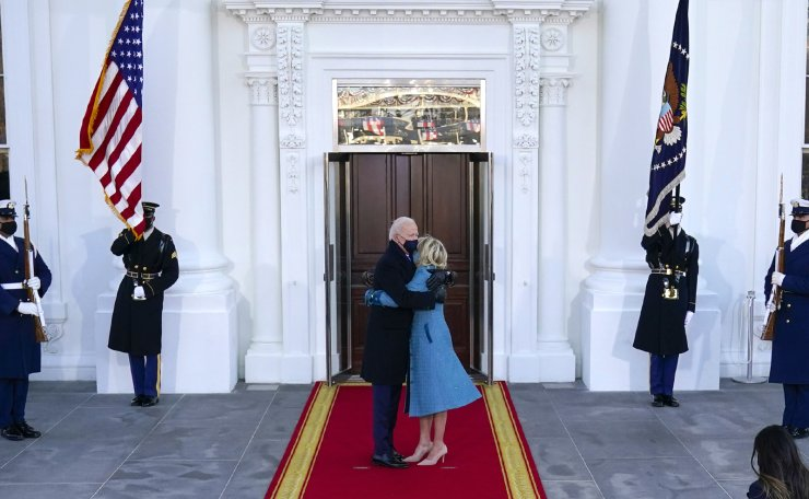 President Joe Biden and first lady Jill Biden hug as they arrive at the North Portico of the White House, Wednesday, Jan. 20, 2021, in Washington. AP