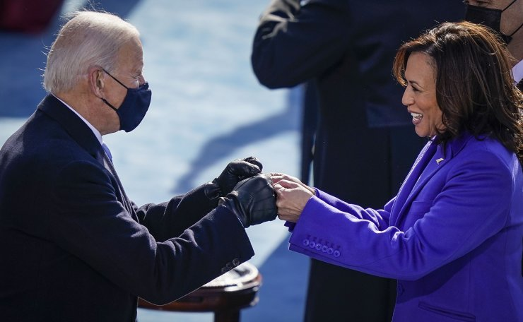 U.S. President-elect Joe Biden fist bumps newly sworn-in Vice President Kamala Harris after she took the oath of office on the West Front of the U.S. Capitol on January 20, 2021 in Washington, DC. AFP
