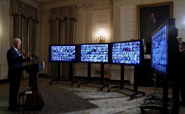 President Joe Biden speaks during a virtual swearing in ceremony of political appointees from the State Dining Room of the White House on Wednesday, Jan. 20, 2021, in Washington. AP