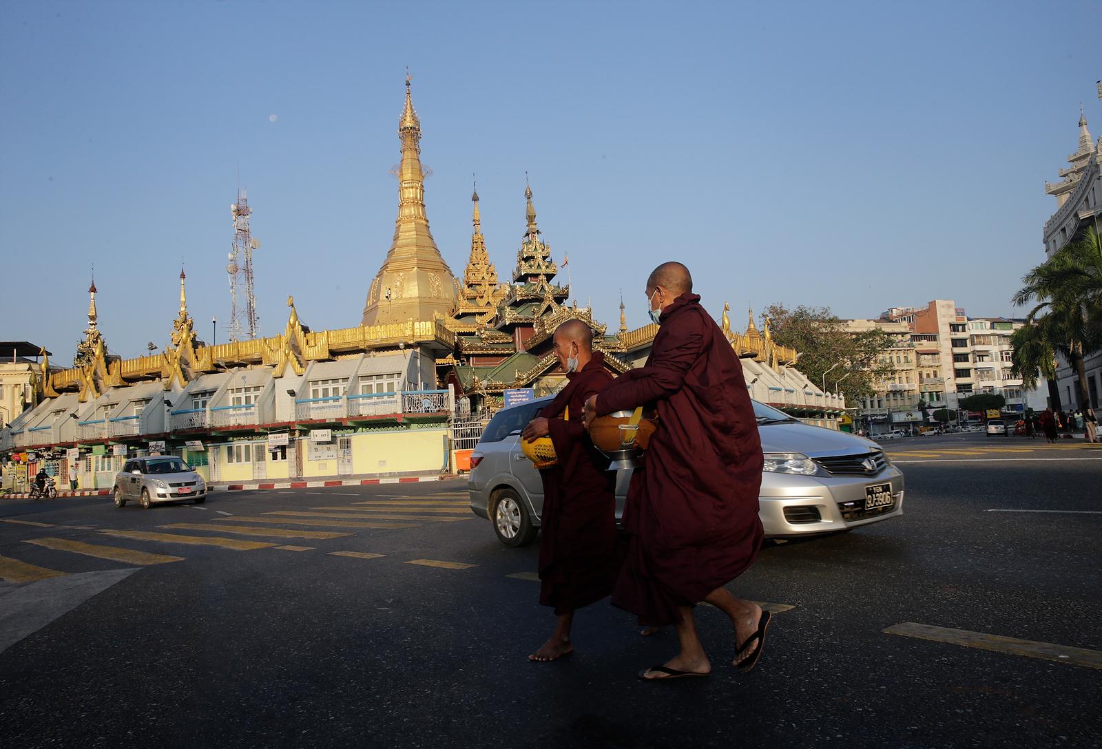 Buddhist monks walks in front of Sule Pagoda near Yangon city hall in Yangon, Myanmar, 01 February 2021. EPA