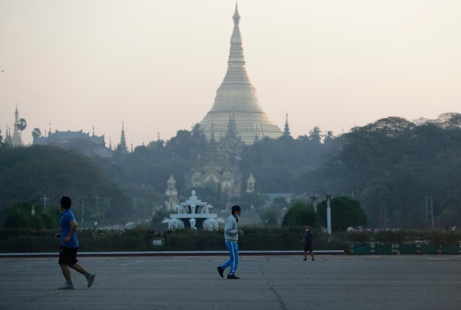 People take exercises at people park near holy Shwedagon pagoda in Yangon, Myanmar, 01 February 2021. EPA
