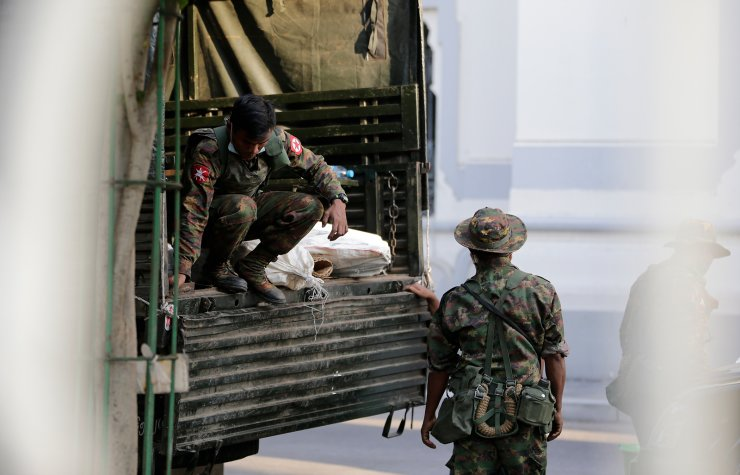 Military soldiers move bags from a truck into Yangon City Hall, in Yangon, Myanmar, 01 February 2021. EPA