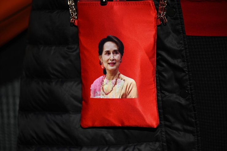 A portrait of Myanmar's de facto leader Aung San Suu Kyi is seen on a bag as Myanmar activists protest outside the United Nations university building in Tokyo on February 1, 2021. AFP