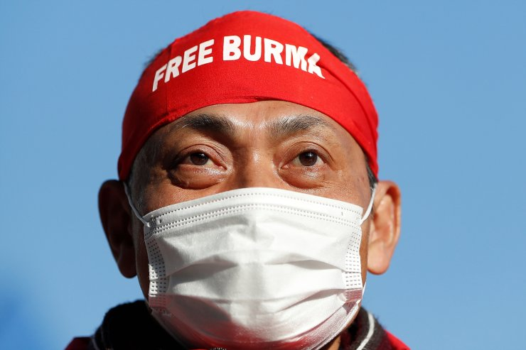 Protester wearing 'Free Burma' headwear rallies against Myanmar's military after it seized power from a democratically elected civilian government and arrested its leader Aung San Suu Kyi, at United Nations University in Tokyo, Japan February 1, 2021. REUTERS