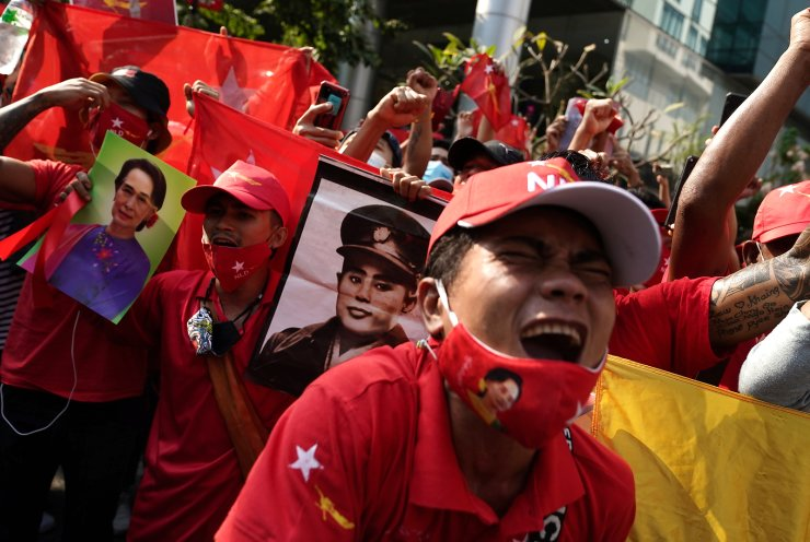NLD supporters shout slogans in front of the Myanmar embassy during a rally after the military seized power from a democratically elected civilian government and arrested its leader Aung San Suu Kyi, in Bangkok, Thailand February 1, 2021. REUTERS