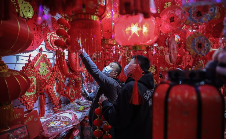 Chinese people shop for new year decorations for the upcoming Chinese Lunar New Year at a market in Beijing, China, 01 February 2021. The Lunar New Year, also known as Spring Festival, falls on 12 February 2021, marking the beginning of the Year of the Ox.  EPA