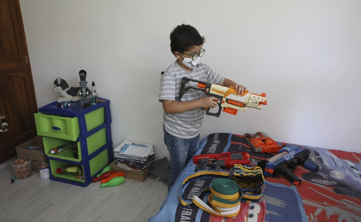 Francisco Vera, well-known in Colombia for his environmental campaigns and defense of children's rights, plays with his toys at home in Villeta, Colombia, Saturday, Jan. 30, 2021.