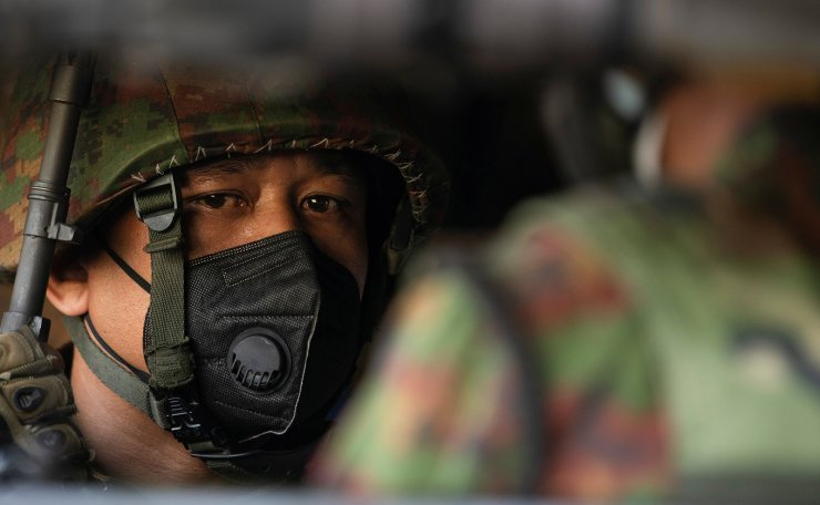 Myanmar soldier sits inside a military vehicle in front of a Hindu temple in the downtown area, in Yangon, Myanmar, February 2, 2021. REUTERS
