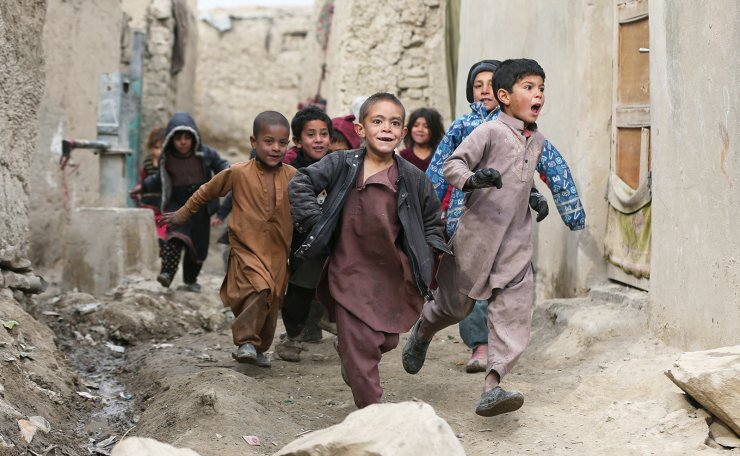 Internally displaced Afghan children play next to their shelters on the outskirts of Kabul, Afghanistan February 3, 2021. REUTERS