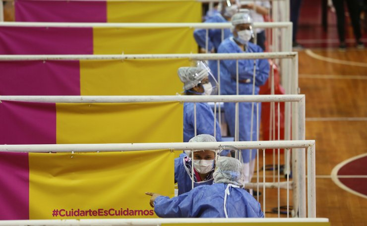 Healthcare workers wait to administer doses of Russia's Sputnik V vaccine against the coronavirus disease (COVID-19) at the basket ball court at the River Plate stadium, in Buenos Aires, Argentina February 3, 2021. REUTERS