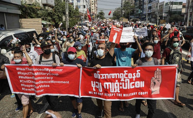 Myanmar people holdiing a large banner reading 'We Do Not Accept The Military Coup' march during a protest against the military coup in Yangon, Myanmar, 07 February 2021. EPA