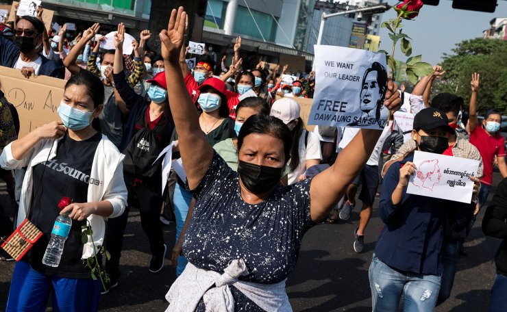People show the three-finger and hold signs demanding the release of elected leader Aung San Suu Kyi during a protest against the military coup, in Yangon, Myanmar, February 7, 2021. REUTERS