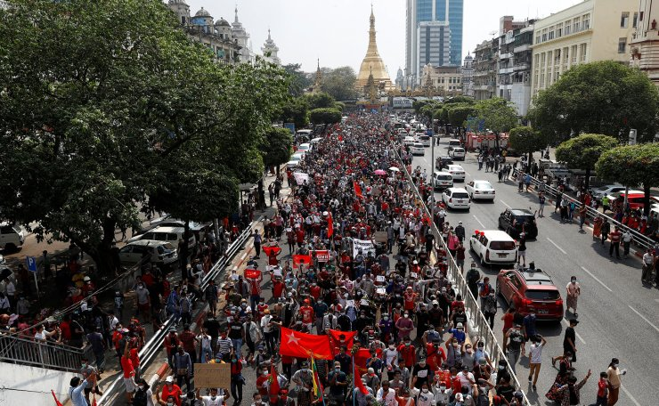 People march in protest against the military coup and to demand the release of elected leader Aung San Suu Kyi, in Yangon, Myanmar, February 7, 2021. REUTERS