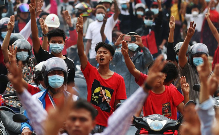 Demonstrators flash the three-finger salute, a symbol of resistance, during a protest against the military coup in Naypyitaw, Myanmar, 07 February 2021. EPA