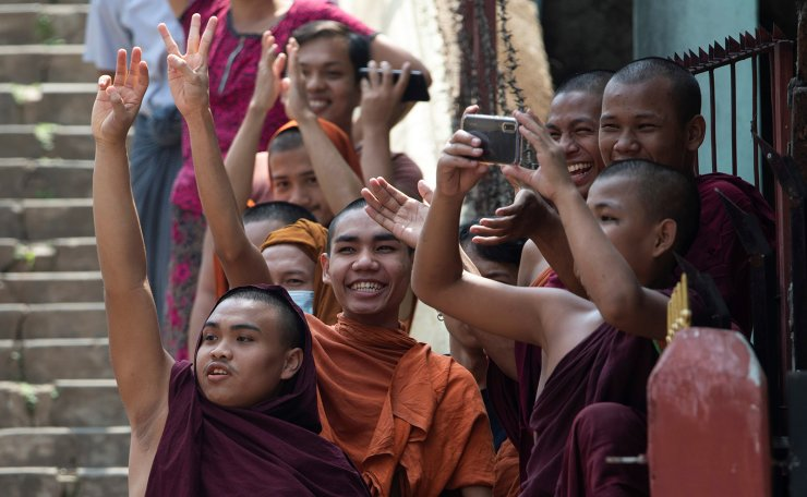Buddhist monks show the three-finger salute as they take part in a protest against the military coup and to demand the release of elected leader Aung San Suu Kyi, in Yangon, Myanmar, February 7, 2021. REUTERS