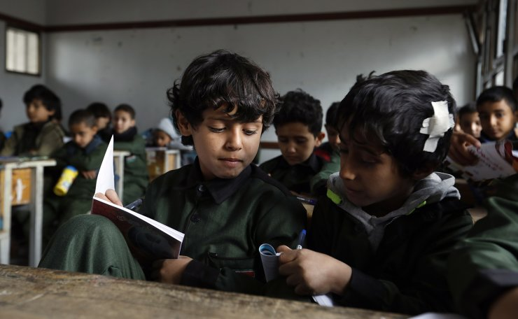 Yemeni schoolchildren attend class as they resume the second term of classes in Sana'a, Yemen, 08 February 2021. EPA