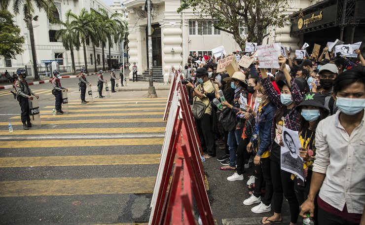 Protesters hold signs as they take part in a demonstration against the military coup in Yangon, Myanmar on Monday, February 8, 2021. UPI