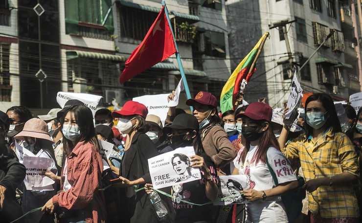 Protesters hold a picture of deposed leader Aung San Suu Kyi  in Yangon, Myanmar on Monday, February 8, 2021. UPI