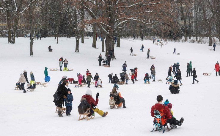 Children take advantage of the fresh snowfall to use their sledges on February 9, 2021 at Volkspark Schoeneberg-Wilmersdorf in Berlin. AFP