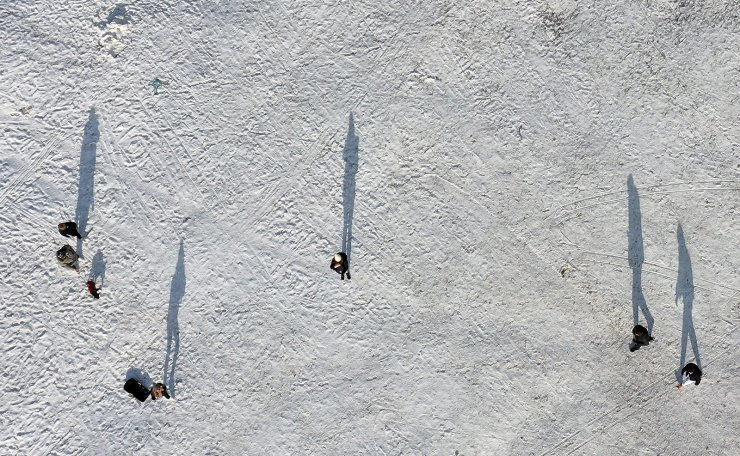 An aerial view shows members of the public walking and sledging at Beverley Westwood park in Beverley, northeast England on February 10, 2021. AFP