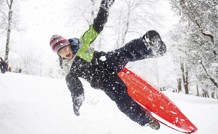 Andrew Forslund, 10, loses control of his sled as he catches air on a ramp at Wright Park as snow falls in Tacoma, Wash., on Saturday, Feb. 13, 2021. A winter storm blanketed the Pacific Northwest with ice and snow Saturday, leaving hundreds of thousands of people without power and disrupting travel across the region. AP