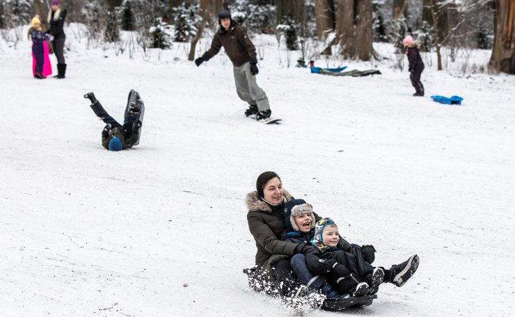 People sled on the snow in Frederiksberg Garden, Copenhagen, Denmark February 16, 2021. REUTERS