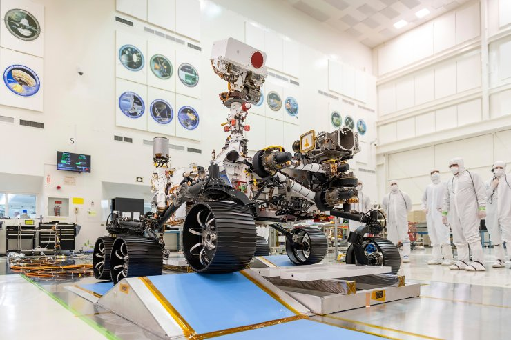 FILE - In this Dec. 17, 2019 photo made available by NASA, engineers watch the first driving test for the Mars 2020 rover, later named 'Perseverance,' in a clean room at the Jet Propulsion Laboratory in Pasadena, Calif. AP/NASA