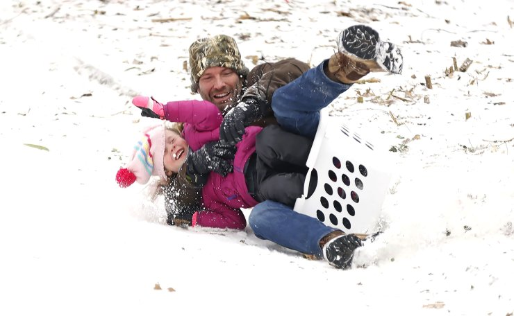 People sled down a hill after a snow storm on February 17, 2021 in Fort Worth, Texas. Winter storm Uri has brought historic cold weather and power outages to Texas as storms have swept across 26 states with a mix of freezing temperatures and precipitation. AFP
