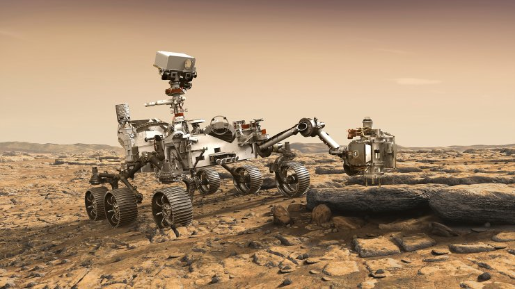 In this illustration made available by NASA, the Mars 2020 Perseverance rover studies a Mars rock outrcrop. AP/NASA